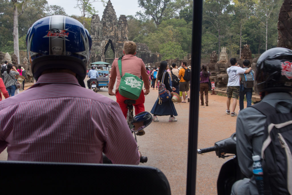 riding to the angkor complex by tuk tuk