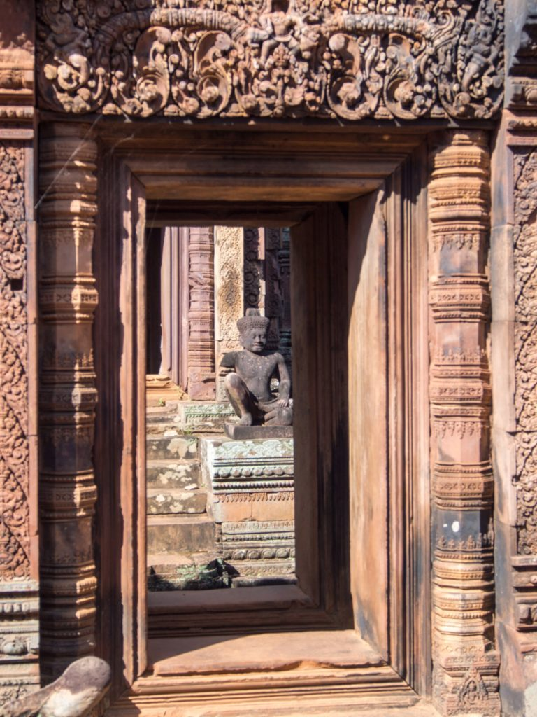 monkey guardian in a an intricately carved door frame